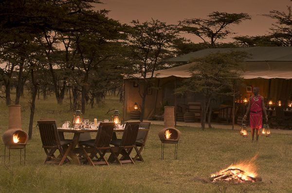 alfresco dining at the Kicheche Bush Camp at dusk